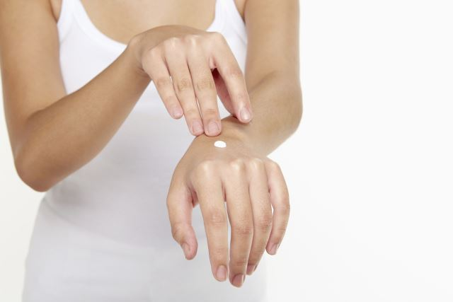 skin cream on hand